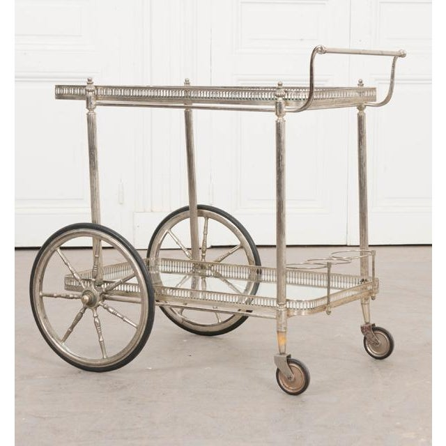 This fabulous vintage silvered metal bar cart, c. 1940's, is from France. Created in the Maison Jansen, Paris,...