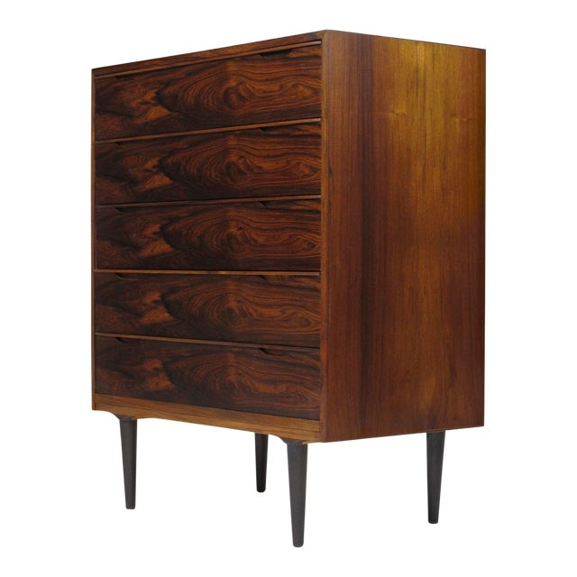Mid-century Danish dresser crafted of Brazilian Rosewood with stunning pattern match on front of drawers. Interior drawers...