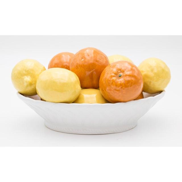 """Lovely Mid-Century Italian majolica bowl of lemons in a white latticework bowl. Marked """"Horchow Italy"""" on reverse. Freshen..."""