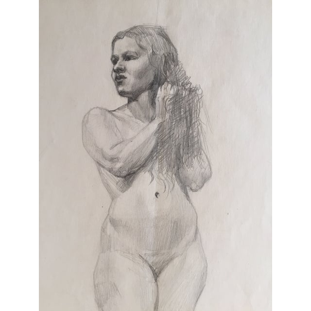 A mid century vintage c.1950 pencil drawing of a standing female nude.