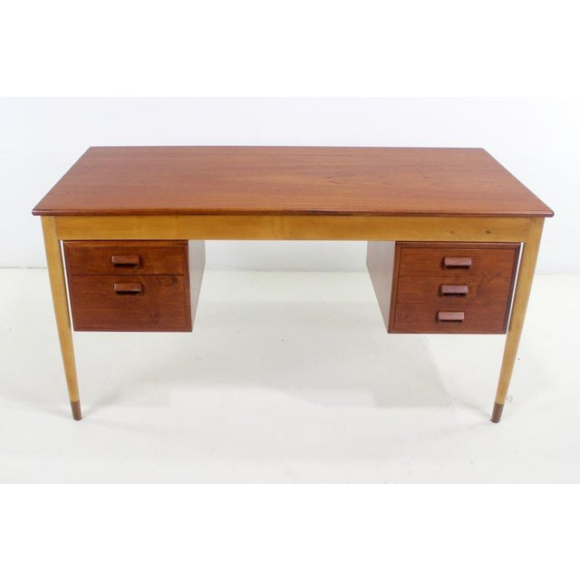 Very desirable, early, Scandinavian Modern executive desk designed by Borge Mogensen. 1951. Teak top, beech sides and...