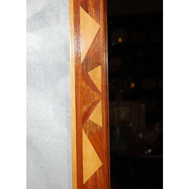 This is a nice wall mirror that will be an asset to all types of settings. The decorative angular patterning, which is...