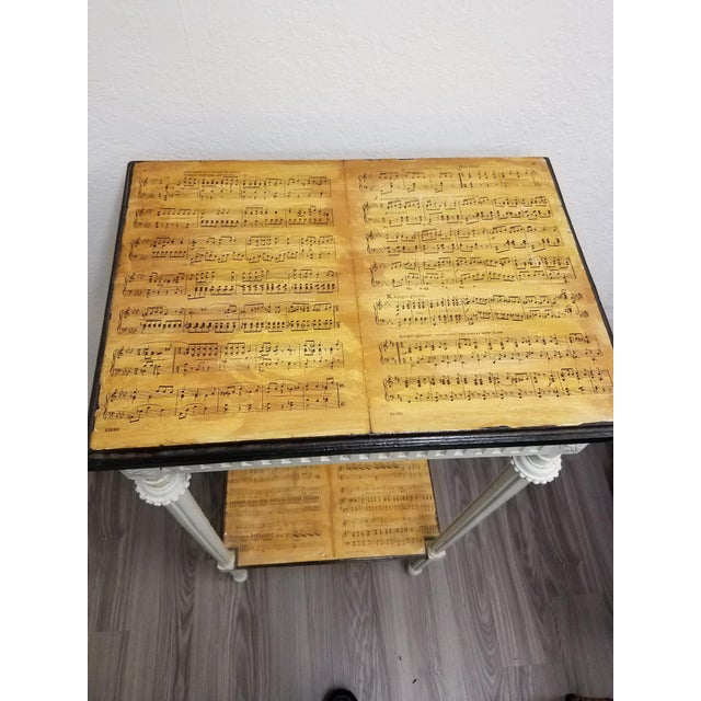 Originally, this piece was likely used as a plant stand or a stand to display a vase or piece of art. The artist who...