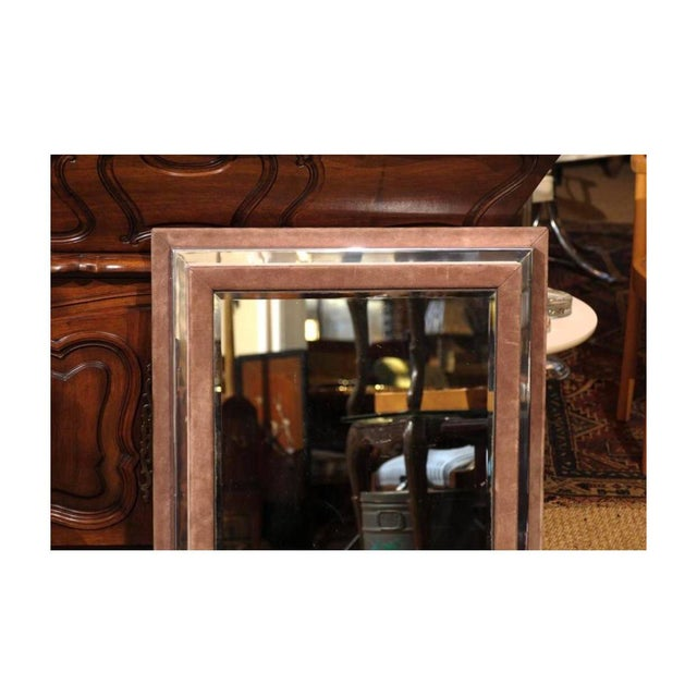 Unique Art Deco period mirror made of a back suede box frame with a chrome frame layered above. The top panel is another...