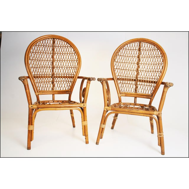 Nice rounded chairs made of wicker/rattan. Pieces have a nice streamlined Modernist design. Each measures approximately...