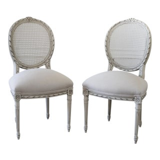 Pair of Louis XVI Style Ribbon Carved Cane Back Side Chairs For Sale