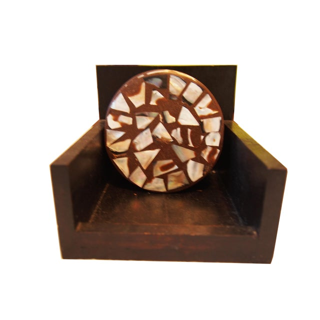 """Set of mother of pearl accented coasters with storage box. Coasters are 4"""" diameter. Box is 5""""x5""""x5"""""""