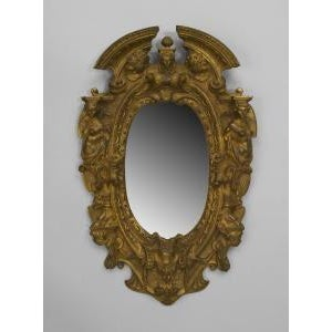 American Victorian style (1st qtr 20th Cent) gilt bronze oval wall mirror frame with cupid heads and figures on side with...
