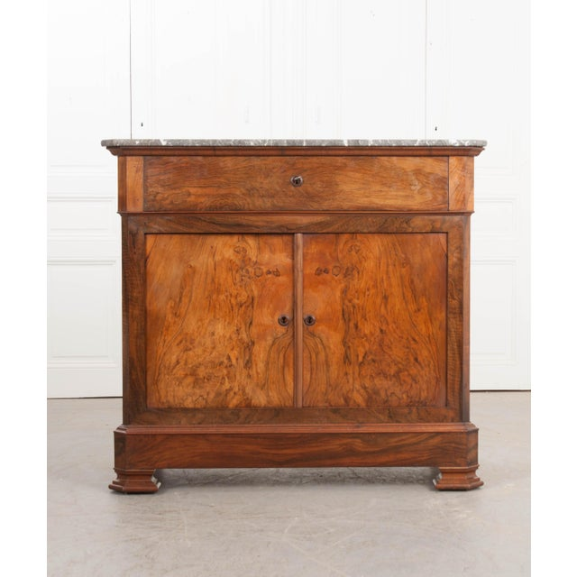 This handsome Louis Philippe marble-top walnut desk, c. 1830's, is from France and features charcoal-grey marble with...