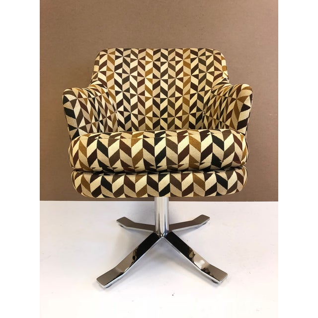 Set of six Zographos swivel chairs. Each chair has four stainless steel bases and the original fabric.