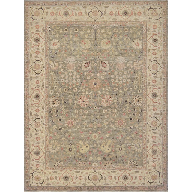 Brand new Tabriz handwoven by master weavers in Egypt, this decorative rug features a light green field, beautiful color...
