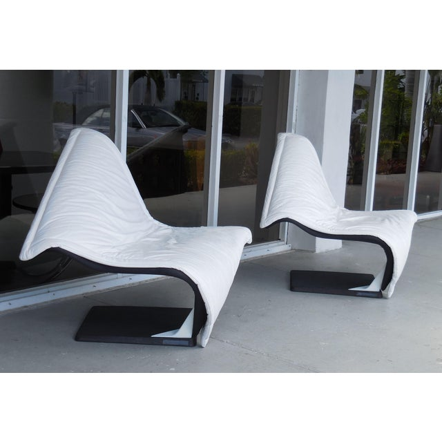 A pair of the iconic flying carpet chairs by Simon Desanta.