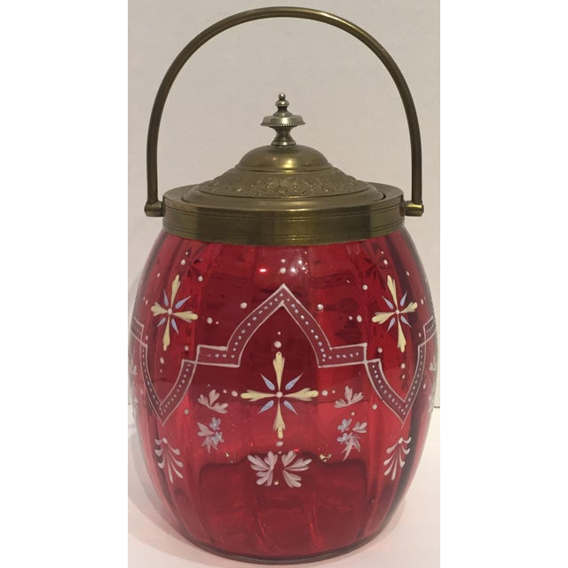 Hand enameled Cranberry glass biscuit barrel with patina brass lid & handle. Exquisite example of the style.