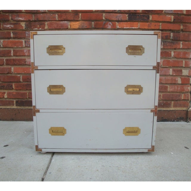 Vintage campaign dresser with recessed brass pulls and low bun feet, circa 1970. Good mid-sized piece can go anywhere in...