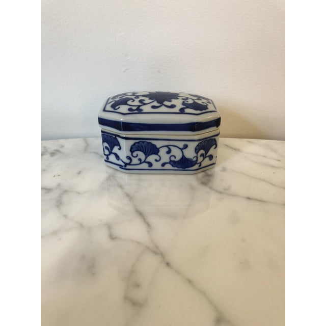 Beautiful blue and white ceramic chinoiserie style box; Long octagon in shape. Piece is perfect for holding jewelry,...
