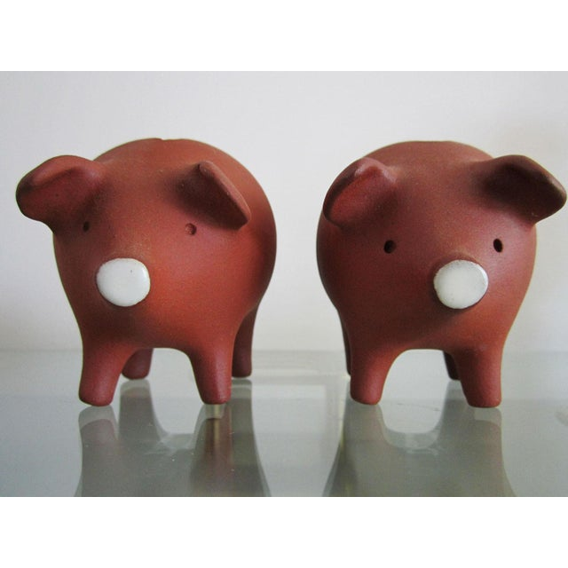 Pair of Danish pottery piggy banks that are signed on each belly.