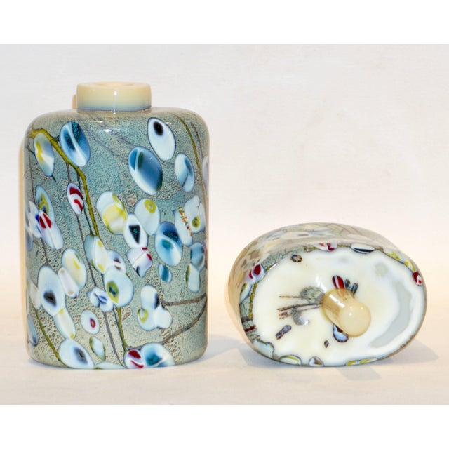 Italian pair of Museum quality Murano glass perfume bottles by Maestro Pino Signoretto, signed. The blown Murano glass...