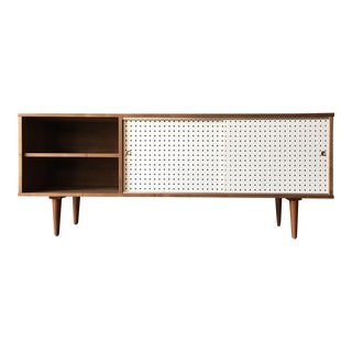 Custom Walnut credenza with perforated doors and metal track For Sale