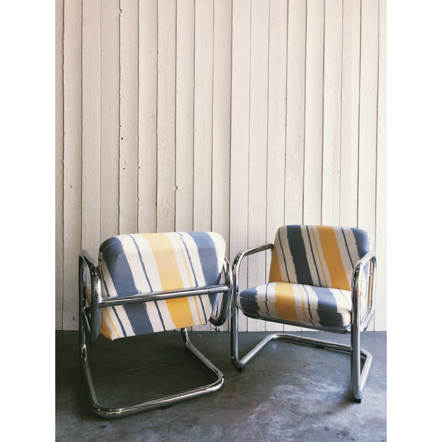 Awesome, original late 70's fabric, heavy duty chrome cantilever armchairs by Kinetics Furniture Inc. They are...
