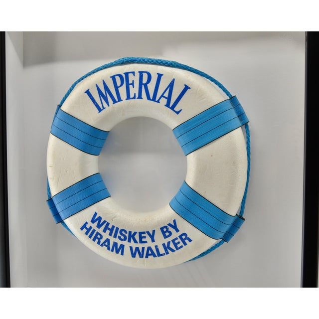 Vintage advertising sign as a life ring. Great decor for pool or your yacht. Museum framing with UV acrylic not glass.