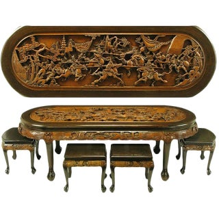 Chinese Oval Coffee Table with Hand Carved Battle Scene and Six Stools For Sale