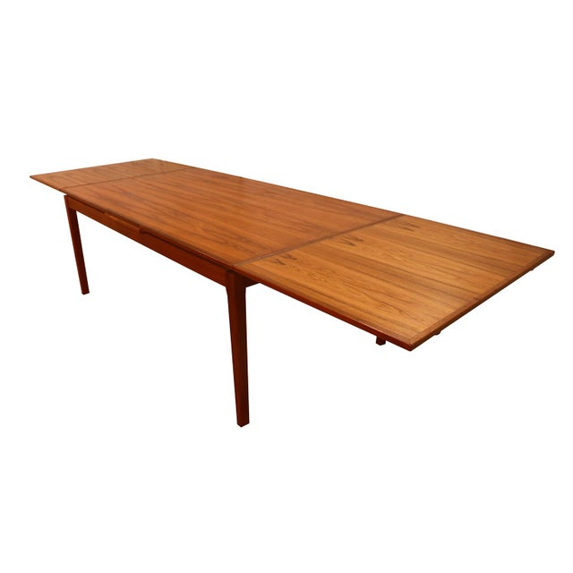 Exceptional Danish Modern teak extension dining table. This gorgeous Danish Teak extending dining table remains in...