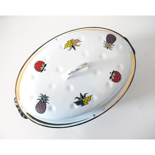 Fabulous vintage enameled roaster in the Ambrosia pattern with a metal warming stand, designed by Georges Briard. The...