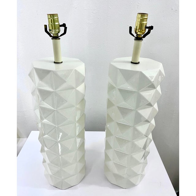 These fabulous white ceramic table lamps featuring substantial proportions and unusual diamond quilted raised pattern,...