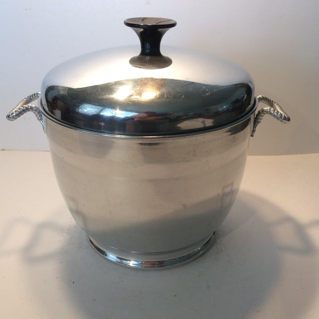 Sweet little stainless steel insulated 2 pound ice bucket with aluminum handles. Great for smaller gatherings it has...