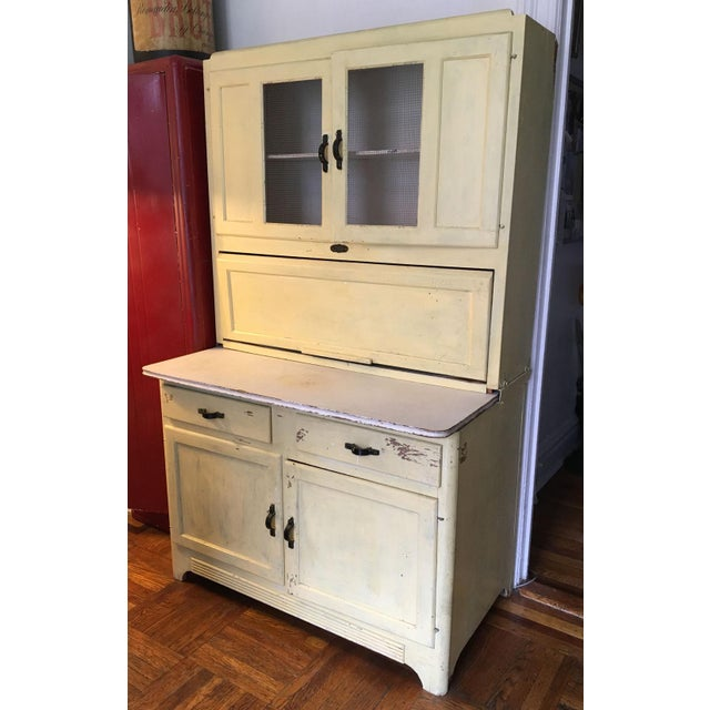 Classic American farmhouse/country piece dates back to the 1940s/50s. Fully functional with a distressed wash of yellow...