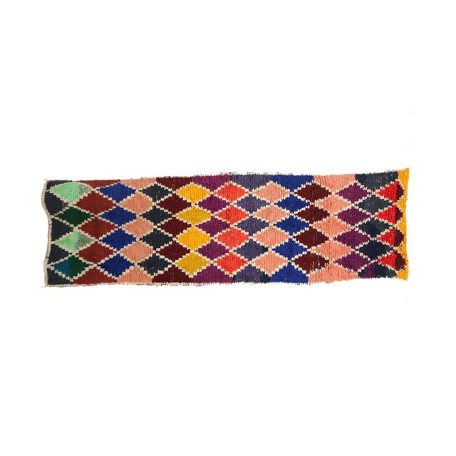 Boucherouite rugs are colorful flat-weave, one-of-a-kind rag rugs - made of recycled remnants of fabric - but in the hands...