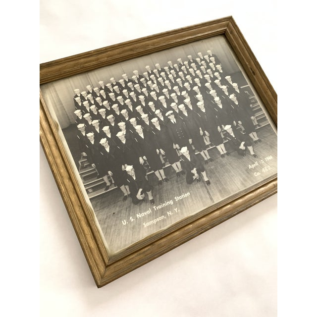 Group portrait photograph of wartime US Navy company. Framed, unsigned. Hook at back for easy hanging. U.S. Naval Training...
