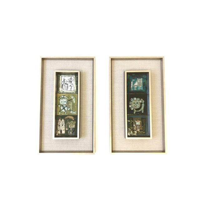 A pair of Italian studio ceramics hand-painted and glazed tiles by Bruno Capacci. Set of three tiles in each frame. Newly...
