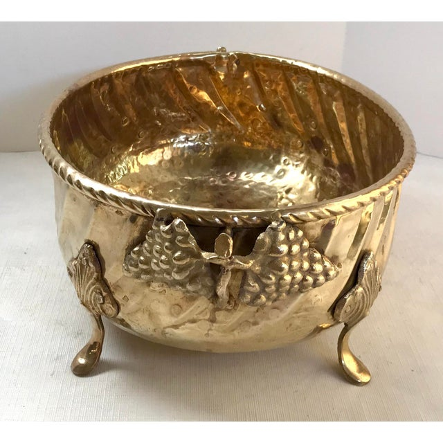 This one is really nice! Beautiful Hammered Brass Planter with Grape handles and footed. Nice for a centerpiece...
