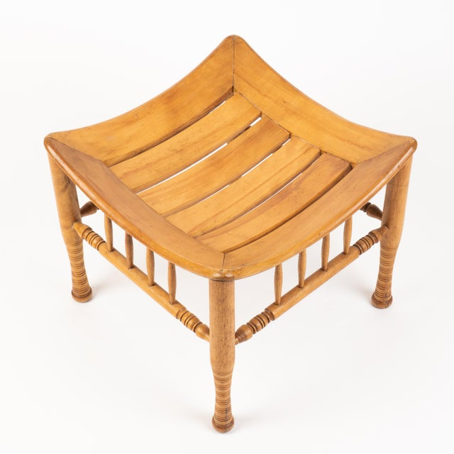 """Egyptian Revival """"Thebian"""" style stool in naturally finished birch wood, after an archeological model. The four turned..."""