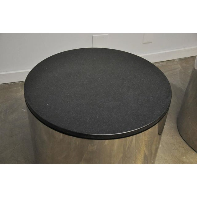 Pair of stainless and black granite side tables by Paul Mayan for Habitat.