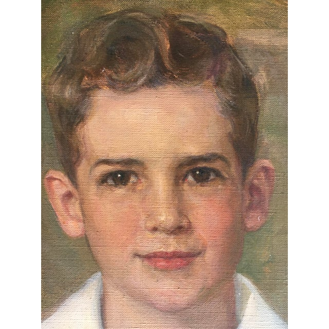 Fantastic oil on canvas painting of a very cheeky young man with a wonderful smile.dated 1952. Signed at lower fight...