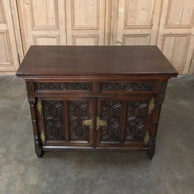 19th Century French Gothic Buffet is a marvel of the wood-crafter's art, with incredible bas relief carvings across the...