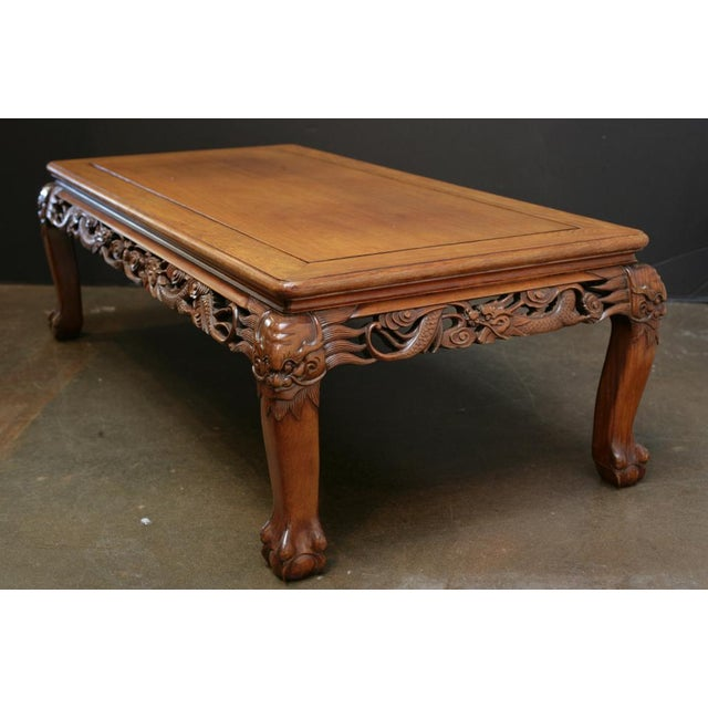 A well proportioned Chinese carved hardwood table. The top is comprised of a single, solid floating panel. The apron has...