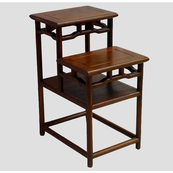 Constructed the traditional Chinese joinery technique, this accent table with two shelves and openwork around creates...