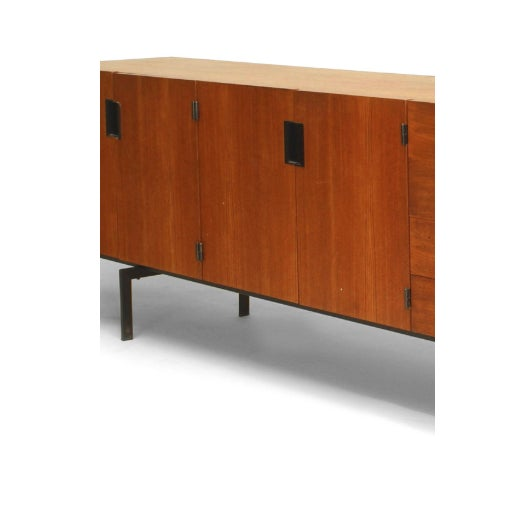 1950's Dutch teak sideboard supported on black metal legs with two pair of doors and two pair of drawers (by Cees Braakman...