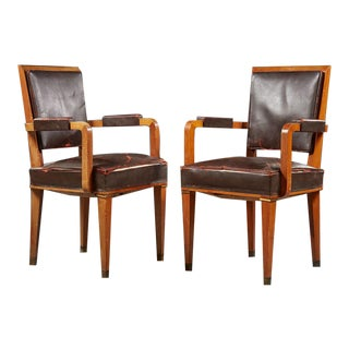 Jacques Adnet (1900-1984), Circa 1940-1950, Suite of Twelve Armchairs For Sale