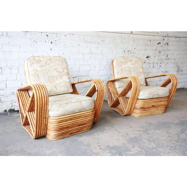 Offering a very nice pair of bamboo Pretzel chairs attributed to Paul Frankl. The chairs feature an unmistakable six-...