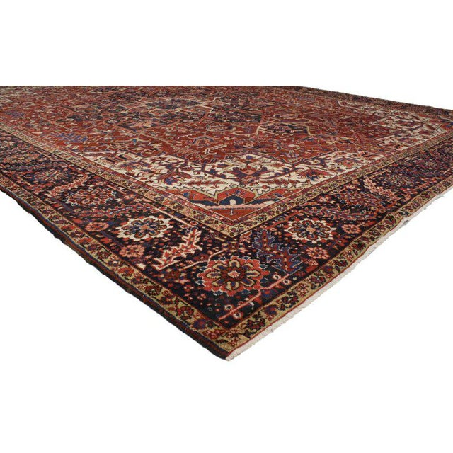This oversize antique Persian Heriz rug features modern traditional style with classical elements of Persian rug design in...