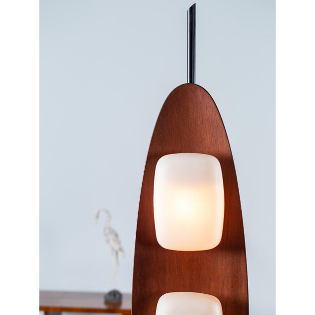 A cool vintage Italian teakwood surfboard floor lamp by Goffredo reggiani circa 1970. This rare Reggiani lamp showcases...
