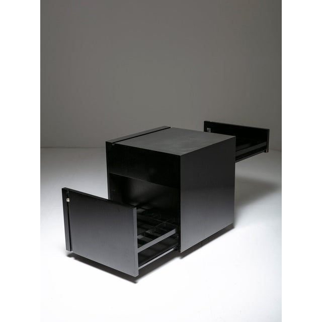 Cubo Bar by Studio O.P.I. for Cini & Nils. Sleek capable piece with two drawers ready to host up to 25 bottles and 50...