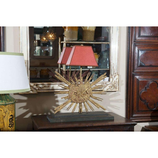 Carved giltwood sunburst mounted as a lamp; French circa 1890.