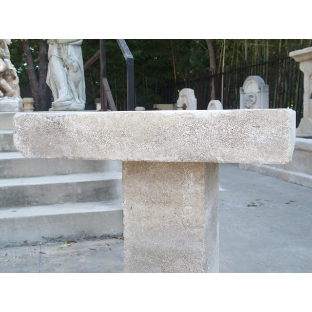 From France, this hand carved square limestone bistro table top has a square pedestal (2 pieces). In Provence, it is...