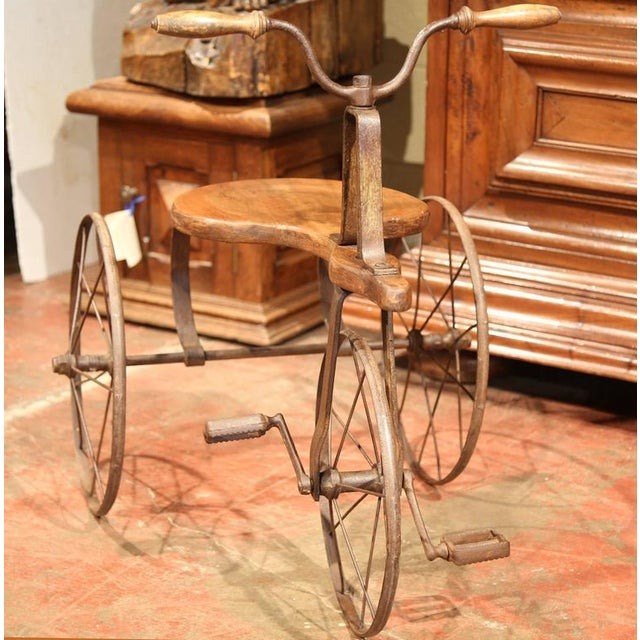 This beautiful, antique tricycle was created in France, circa 1880. The authentic children's toy is in excellent working...