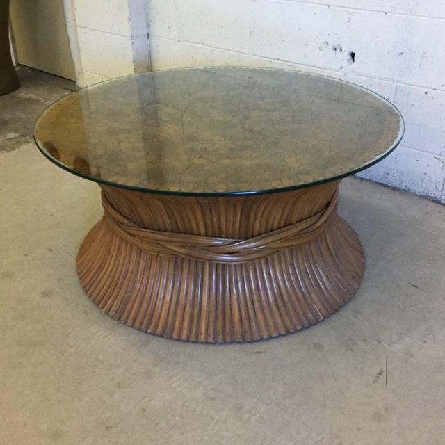 Round sheaf of wheat mid century coffee table by McGuire. Beautiful color and great vintage condition. Includes glass top....